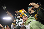 Green Bay Packers running back Brandon Jackson joins the fans after his rushing touchdown against the Dallas Cowboys during the game at Lambeau Field on Nov. 7 , 2010.