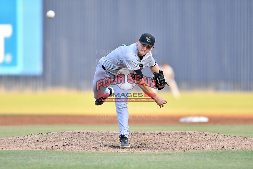 Augusta GreenJackets starting pitcher Keaton Winn (12) delivers a pitch during a game against the Asheville Tourists at McCormick Field on June 5, 2019 in Asheville, North Carolina. The Tourists defeated the GreenJackets 4-3. (Tony Farlow/Four Seam Images)