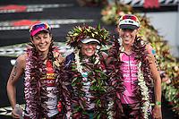 Rachel Joyce, Mirinda Carfrae and Liz Blatchford pose for the cameras at the 2013 Ironman World Championship in Kailua-Kona, Hawaii on October 12, 2013.