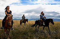 """Rowan, a five-year-old autistic child, riding a horse, accompanied by his parents, Kristin Neff and Rupert Issacson, and their guide, Tulga, during a horseback expedition across Mongolia. Rowan, who has been nicknamed """"The Horse Boy"""", embarked on a therapeutic journey of discovery with his parents to visit a succession of shaman healers in one of the most remote regions in the world. Following Rowan's positive response to a neighbour's horse, Betsy, and some reaction to treatment by healers, Rowan's parents hoped that the Mongolian shamanistic rituals along the route and the prolonged contact with horses would help to unlock their son's autism and assist his development.."""