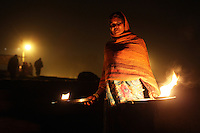 A women takes part in a Hindu ceremony on the banks of the Ganges River, in northern Kanpur. A number of religious leaders are trying to educate the public about the harmful effects of the local leather producing tanneries.