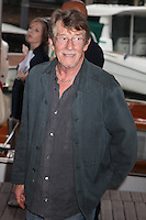 """JOHN HURT LEAVES THE LIDO CASINO AFTER THE PHOTOCALL OF THE FILM 'TINKER, TAILOR, SOLDIER, SPY' - 68TH INTERNATIONAL VENICE FILM FESTIVAL """"LA TAUPE"""""""