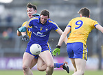Cathal O Connor of Clare in action against Tadgh O Rourke and Cathal Compton of Roscommon during their National League game at Cusack Park. Photograph by John Kelly.