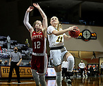 SIOUX FALLS, SD - MARCH 7: Heaven Hamling #11 of the North Dakota State Bison takes the ball tot her basket past Claire Gritt #12 of the Denver Pioneers during the Summit League Basketball Tournament at the Sanford Pentagon in Sioux Falls, SD. (Photo by Dave Eggen/Inertia)