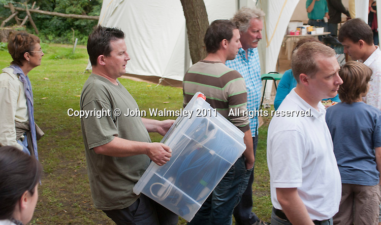 Carrying the box of cables to the stage at the reunion for Summerhill School's 90th birthday celebrations.