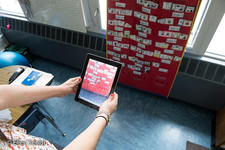 MR / Schenectady, NY. Zoller Elementary School (urban public school). Kindergarten classroom. Teacher uses iPad to take a picture of classroom environment. MR: She4. ID: AM-gKw. © Ellen B. Senisi.