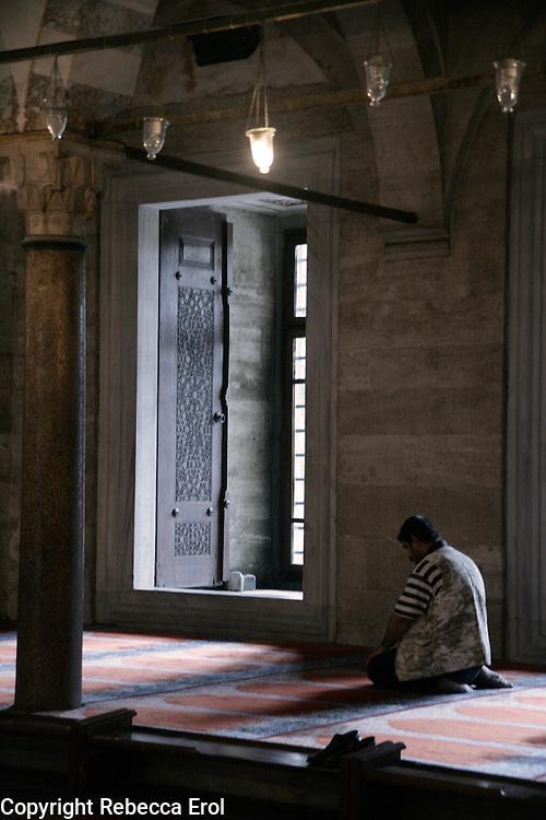 Worshiper praying at the Suleymaniye Mosque, Istanbul, Turkey