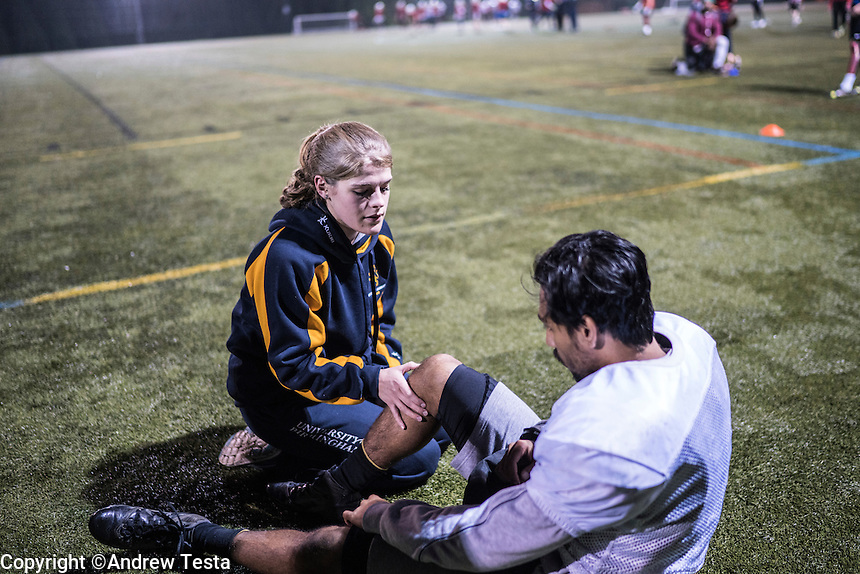UK. Birmingham.  29th  October 2015<br /> An injured Lions player is checked by a medic during an outdoor training session.<br /> Andrew Testa for the New York Times