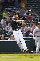 Charlotte Knights third baseman Marcus Semien (6) makes a throw to first base against the Pawtucket Red Sox at BB&T Ballpark on August 9, 2014 in Charlotte, North Carolina.  The Red Sox defeated the Knights  5-2.  (Brian Westerholt/Four Seam Images)