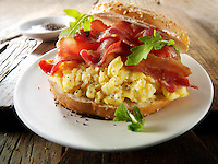 Crispy backon and scrambled eggs on a bagel