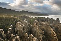 Sunrise over limestone formations, pancake rocks at Dolomite Point in Punakaiki, Paparoa National Park, West Coast, Buller Region, New Zealand, NZ