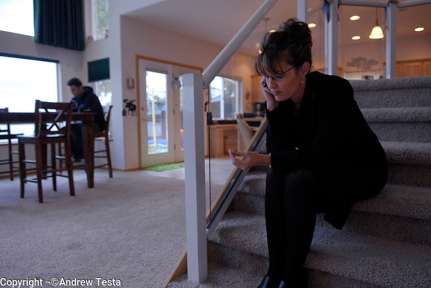 USA. Wasilla.  13th September 2007.The Governor talks on the phone at her home in Wasilla. Her son Track is in rhe background..©Andrew Testa/Panos