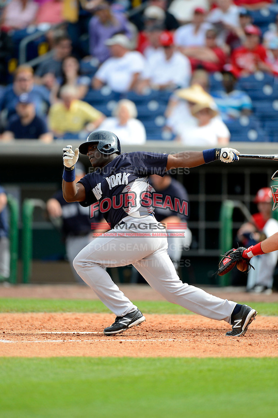 New York Yankees outfielder Runnier Mustelier #95 at bat during a Spring Training game against the Philadelphia Phillies at Bright House Field on February 26, 2013 in Clearwater, Florida.  Philadelphia defeated New York 4-3.  (Mike Janes/Four Seam Images)