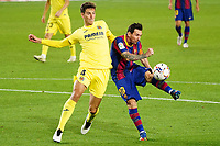 27th September 2020; Camp Nou, Barcelona, Catalonia, Spain; La Liga Football, Barcelona versus Villareal; Leo Messi wraps his foot around the ball and shoots on goal as Torres pressures him