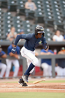 Shortstop Ronny Mauricio (2) of the Columbia Fireflies bats runs out a batted ball in a game against the Rome Braves on Tuesday, June 4, 2019, at Segra Park in Columbia, South Carolina. Columbia won, 3-2. (Tom Priddy/Four Seam Images)