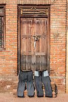 Nepal, Patan.  Pants Drying Outside a Doorway.