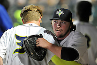 Starting pitcher P.J. Conlon (33) of the Columbia Fireflies gets a hug from Dash Winningham after throwing six innings of one-run ball in the home opener against the Greenville Drive on Thursday, April 14, 2016, the team's first day at the new Spirit Communications Park in Columbia, South Carolina. The Mets affiliate moved to Columbia this year from Savannah. Columbia won, 4-1, and Conlon got the win. (Tom Priddy/Four Seam Images)