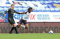 Bolton Wanderers' Peter Kioso is tackled by Oldham Athletic's Danny Rowe<br /> <br /> Photographer Stephen White/CameraSport<br /> <br /> The EFL Sky Bet League Two - Bolton Wanderers v Oldham Athletic - Saturday 17th October 2020 - University of Bolton Stadium - Bolton<br /> <br /> World Copyright © 2020 CameraSport. All rights reserved. 43 Linden Ave. Countesthorpe. Leicester. England. LE8 5PG - Tel: +44 (0) 116 277 4147 - admin@camerasport.com - www.camerasport.com