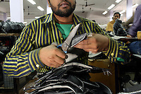 A factory worker making leather shoes in a workshop in the Jajmau area of Kanpur.