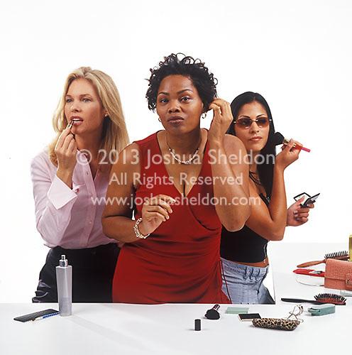 Three women primping<br />