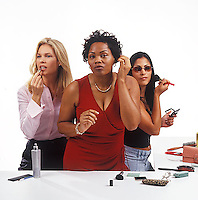 Three women primping<br />