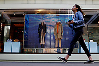 NEW YORK, NEW YORK - MARCH 12: A woman walks in front a Burberry store on March 12, 2021 in New York. Burberry expects full-year profits to beat market forecasts after a rebound in sales in the fourth quarter, sending its shares more than 6% higher. (Photo by Emaz/VIEWpress)