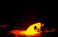 A lava bubble explodes from Kilauea Volcano at Hawaii Volcanoes National Park.