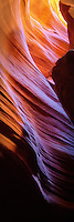 A vertical pano of a colorful segment of sandstone in Arizona's Antelope Canyon.