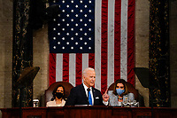 WASHINGTON, DC - APRIL 28: President Joe Biden, flanked by Vice President Harris and House Speaker Nancy Pelosi (D-Calif.), addresses a joint session of Congress, with Vice President Kamala Harris and House Speaker Nancy Pelosi (D-Calif.) on the dais behind him, on Wednesday, April 28, 2021. Biden spoke to a nation seeking to emerge from twin crises of pandemic and economic slide in his first speech to a joint session of Congress. <br /> CAP/MPI/RS<br /> ©RS/MPI/Capital Pictures