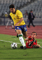 Brazil's Diogo (6) moves the ball between Germany's defense during the FIFA Under 20 World Cup Quarter-final match at the Cairo International Stadium in Cairo, Egypt, on October 10, 2009. Germany lost 2-1 in overtime play.