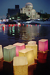 With the backdrop of Atomic-Bombing Dome, paper lanterns float down along Motoyasu River in Hiroshima Sunday, Aug. 6, 1995. The lanterns are to console souls of those who were killed in the atomic bombing 50 years ago. (AP Photo/Paul Sakuma)