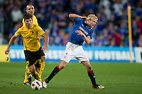 SYDNEY, AUSTRALIA - JULY 31, 2010: Steven Naismith of Rangers is pushed off the ball during the match between AEK Athens FC and Glasgow Rangers at the 2010 Sydney Festival of Football held at the Sydney Football Stadium on July 31, 2010 in Sydney, Australia. (Photo by Sydney Low / www.syd-low.com)