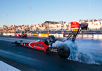 Oct 4, 2020; Madison, Illinois, USA; NHRA top fuel driver Steve Torrence (near) smokes the tires in the final round against Doug Kalitta during the Midwest Nationals at World Wide Technology Raceway. Mandatory Credit: Mark J. Rebilas-USA TODAY Sports