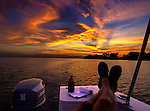 Collecting creative inspiration while watching the north Florida sunset from the boat along the Forgotten Coast of the Florida panhandle coast of Wakulla County,, Florida.<br /> ©2013 Mark Wallheiser