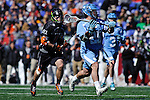 Face-Off Classic: Midfielder Joe Costigan #35 of the North Carolina Tar Heels moves the ball up field during the Princeton v North Carolina mens lacrosse game at M&T Bank Stadium on March 10, 2012 in Baltimore, Maryland. (Ryan Lasek/Eclipse Sportswire)