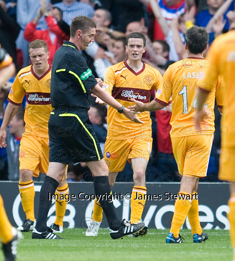 MOTHERWELL'S JAMIE MURPHY'S GOAL CELEBRATION IS CUT SHORT BY REFEREE CRAIG THOMSON AS HE CHOPS IT OFF FOR HAND BALL