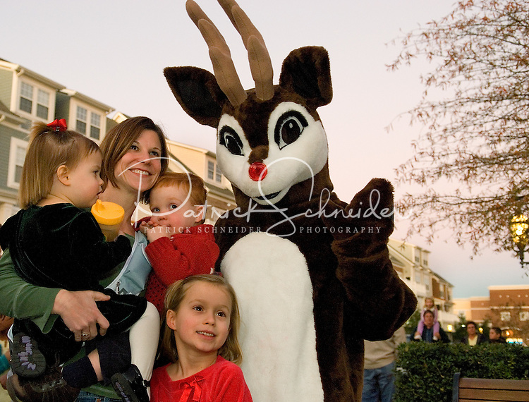Santa greets kids and families during the annual Christmas tree lighting event at Birkdale Village in Huntersville, NC. Birkdale Village combines the best of shopping, dining, apartments and entertainment venues within a 52-acre mixed-use development.