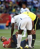 Alexis Sanchez of Chile lies injured during game against Honduras