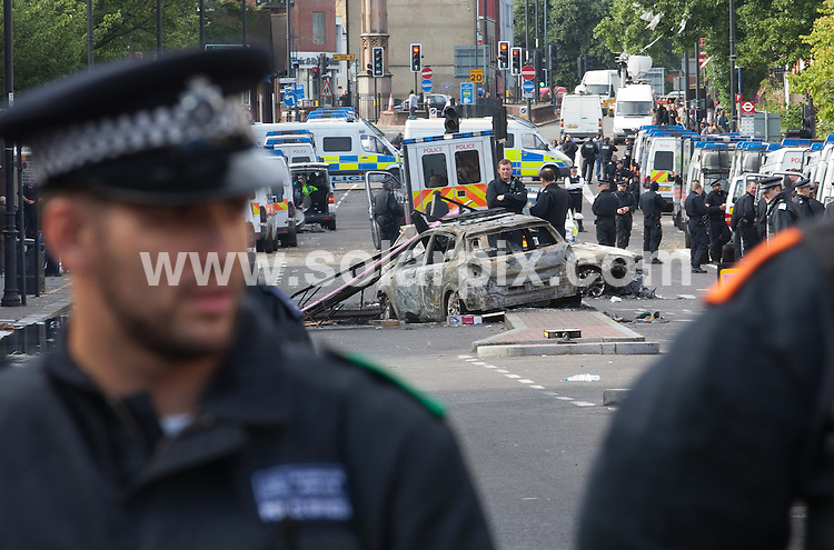 **ALL ROUND PICTURES FROM SOLARPIX.COM**                                             **NO UK NEWSPAPER PUBLICATION**.**UK MAGAZINE & SUPPLEMENT PUBLICATION ONLY** AND NO PUBLICATION IN AUSTRALIA, BELGIUM, FRANCE, GERMANY, ITALY, SCANDINAVIA AND USA**                                                                                  Caption: 29 year old Mark Duggan was shot by officers from the Metropolitan Police's CO19 unit on Thursday evening after the minicab he was travelling in was stopped, sparking riots in Tottenham Hale, North London, UK. 4 August 2011                                                                                     This pic:  Tottenham Riots - 2 Burned out Police cars                                                                            JOB REF: 13824 SFE       DATE: 04_08_2011                                                           **MUST CREDIT SOLARPIX.COM OR DOUBLE FEE WILL BE CHARGED**                                                                      **MUST AGREE FEE BEFORE ONLINE USAGE**                               **CALL US ON: +34 952 811 768 or LOW RATE FROM UK 0844 617 7637**