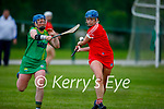 Laura Collins of Kerry attempts to hook Ciara Ring of Cork in the Munster Junior Camogie semi final.