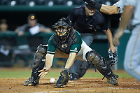 Greensboro Grasshoppers catcher J.D. Osborne (46) fields a throw at home plate during the game against the West Virginia Power at First National Bank Field on August 9, 2018 in Greensboro, North Carolina. The Power defeated the Grasshoppers 9-7 in game two of a double-header. (Brian Westerholt/Four Seam Images)