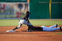 West Virginia Black Bears second baseman Victor Ngoepe (6) tags J.D. Orr (22) out during a NY-Penn League game against the Batavia Muckdogs on June 27, 2019 at Dwyer Stadium in Batavia, New York.  West Virginia defeated Batavia 6-5 in ten innings.  (Mike Janes/Four Seam Images)