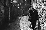 Couple kiss in a back alley Durham, Yorkshire 1974