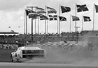 The #11 Chevrolet Camaro of Joe Ruttman, Mike Laws, Daren Schoenfeld, and Tim Richmond spins en route to a 50th place finish in the SunBank 24 at Daytona, Daytona International Speedway, Daytona Beach, FL, Feb. 4-5, 1984. (Photo by Brian Cleary/www.bcpix.com)