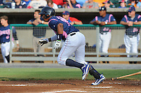 Tennessee Smokies Right Fielder Nelson Perez #14 swings at a pitch during a game against the Chattanooga Lookouts at Smokies Park on June 18, 2011 in Kodak, Tennessee.  Chattanooga defeated Tennessee 5-3.  (Tony Farlow/Four Seam Images)