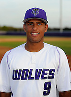 Timber Creek Wolves outfielder Eugene Vasquez #9 poses for a photo before a varsity baseball game against the Oak Ridge Pioneers at Timber Creek High School on February 19, 2013 in Orlando, Florida.  Vasquez is ranked as one of the top 100 draft prospects according to Baseball America and is committed to Central Florida.  (Mike Janes/Four Seam Images)