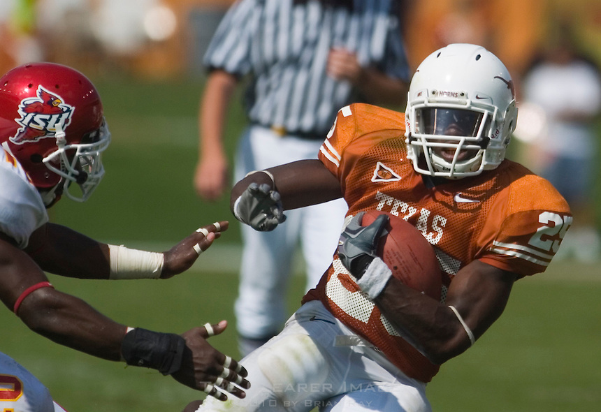 23 September 2006: Texas back Jamaal Charles (#25) dodges a tackle by an Iowa State defender during the Longhorns 37-14 victory over the Iowa State Cyclones at Darrell K Royal Memorial Stadium in Austin, TX.
