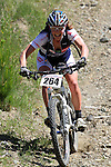 Made it! Anja McDonald is all smiles having negotiated a tricky descent. Mammoth Adventure MTB Ride, Nelson<br /> Photo: Marc Palmano/shuttersport.co.nz