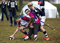 08 MAR 2015 - NOTTINGHAM, GBR - Jerome Vaugarny (left) from Loughborough Longshots attempts to retrieve the quaffle as his team mate Charlie Guy tries to hold off Tom Heynes (right) from Radcliffe Chimeras during the 2015 British Quidditch Cup semi final at Woollaton Hall and Deer Park in Nottingham, Great Britain (PHOTO COPYRIGHT © 2015 NIGEL FARROW, ALL RIGHTS RESERVED)