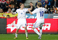 Finland's Ring (l) and Pukki celebrate goal during international match of the qualifiers for the FIFA World Cup Brazil 2014.March 22,2013.(ALTERPHOTOS/Victor Blanco)